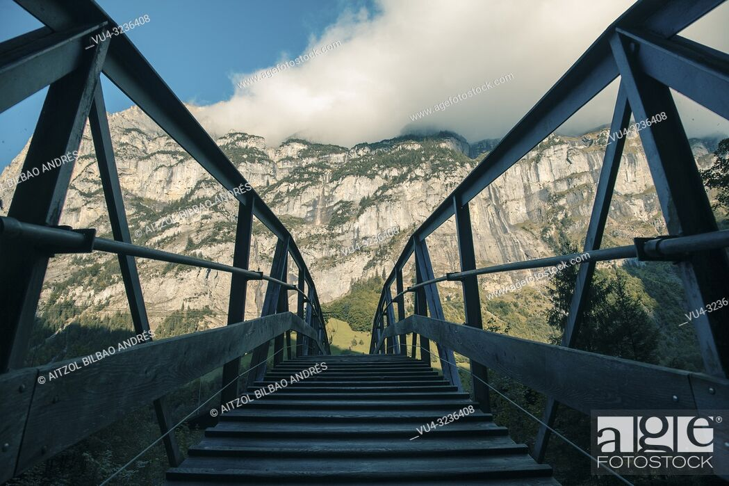 Stock Photo: Small bridge in the Lauterbrunnen valley, Swiss Alps. This valley is one of the beautiful valleys in the Alps.