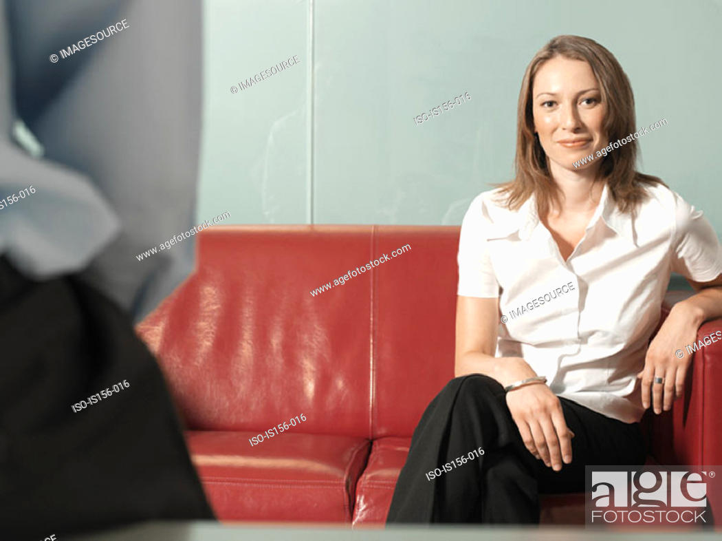 Stock Photo: Office worker sitting on a sofa.