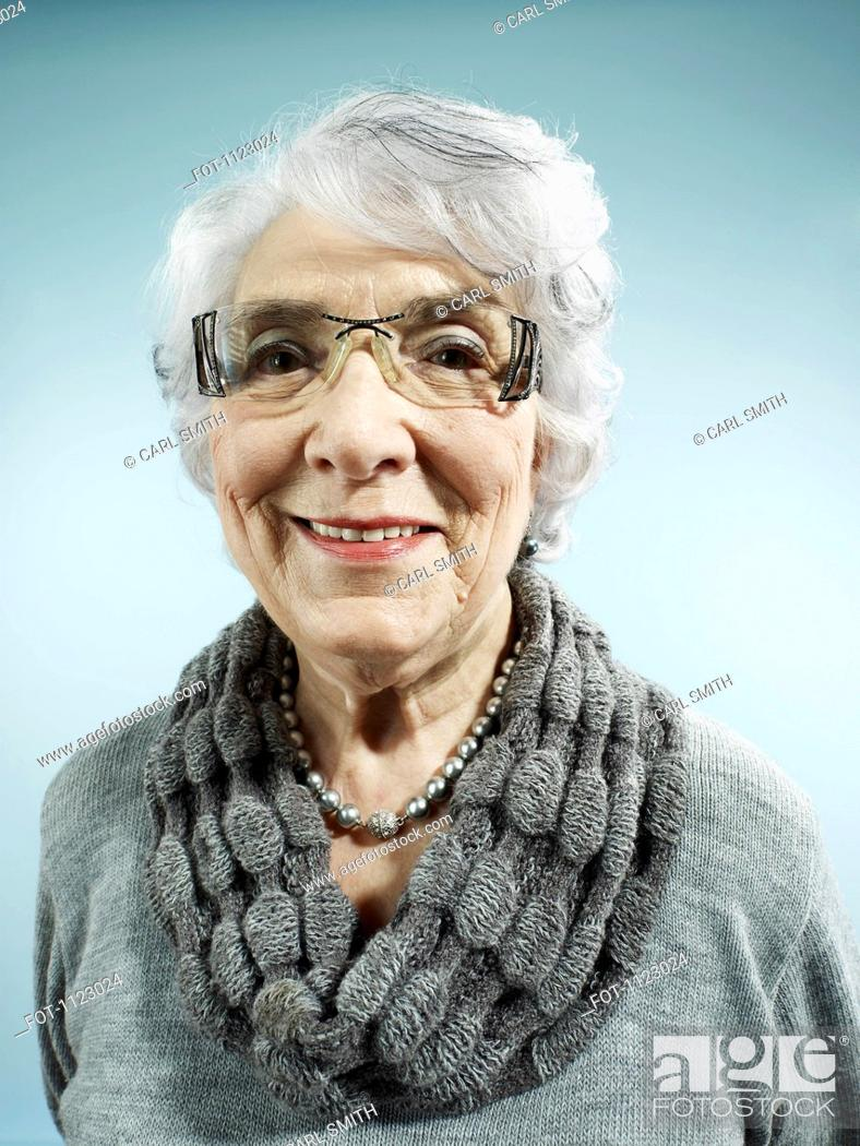 Stock Photo: An elegant senior woman smiling at the camera.