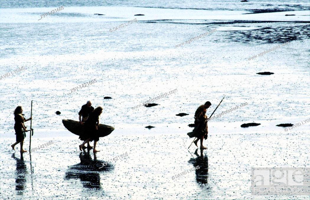 Stock Photo: Neolithic prehistoric cave men walking on mudflats seashore carrying skin boat coracle curragh and spears.