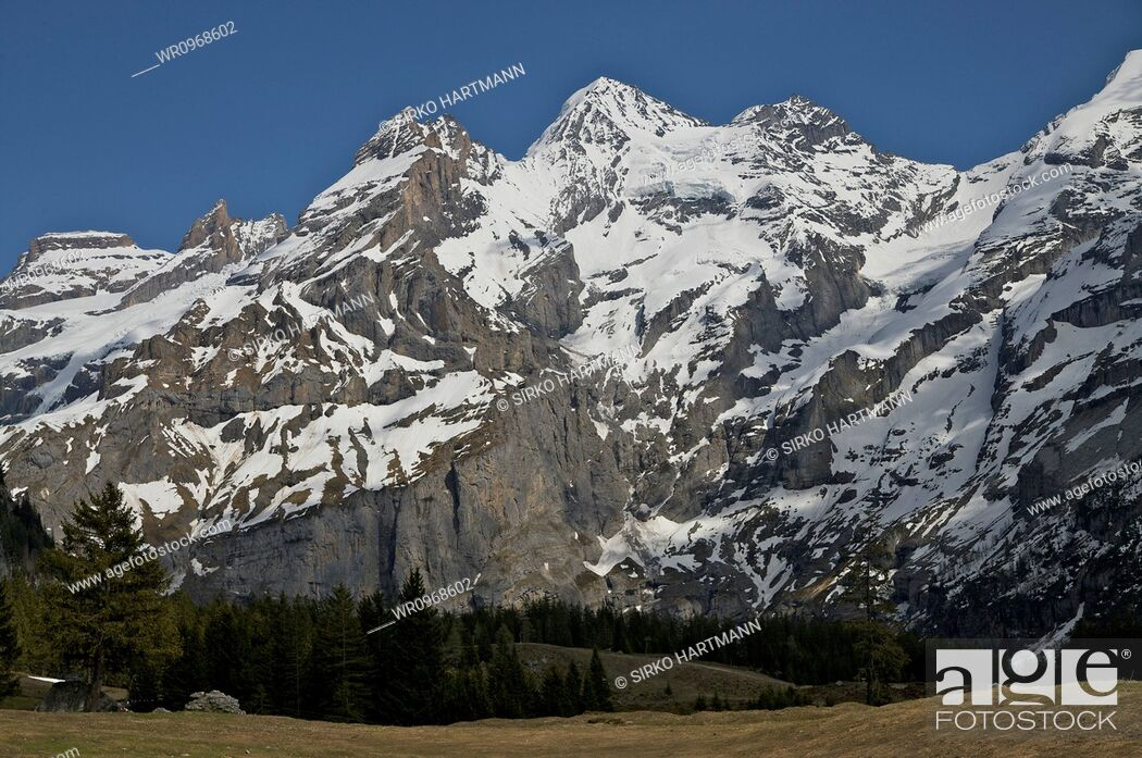 Stock Photo: Nature, Cloud, Mountain, Winter, Travel, Europe, Forest, Tree, Tourism, Snow, Chain, Cloudy, Switzerland, Snow Covered, Snowy, Alps, Geography, Swiss, Touristic, Mountain Range, Landscape