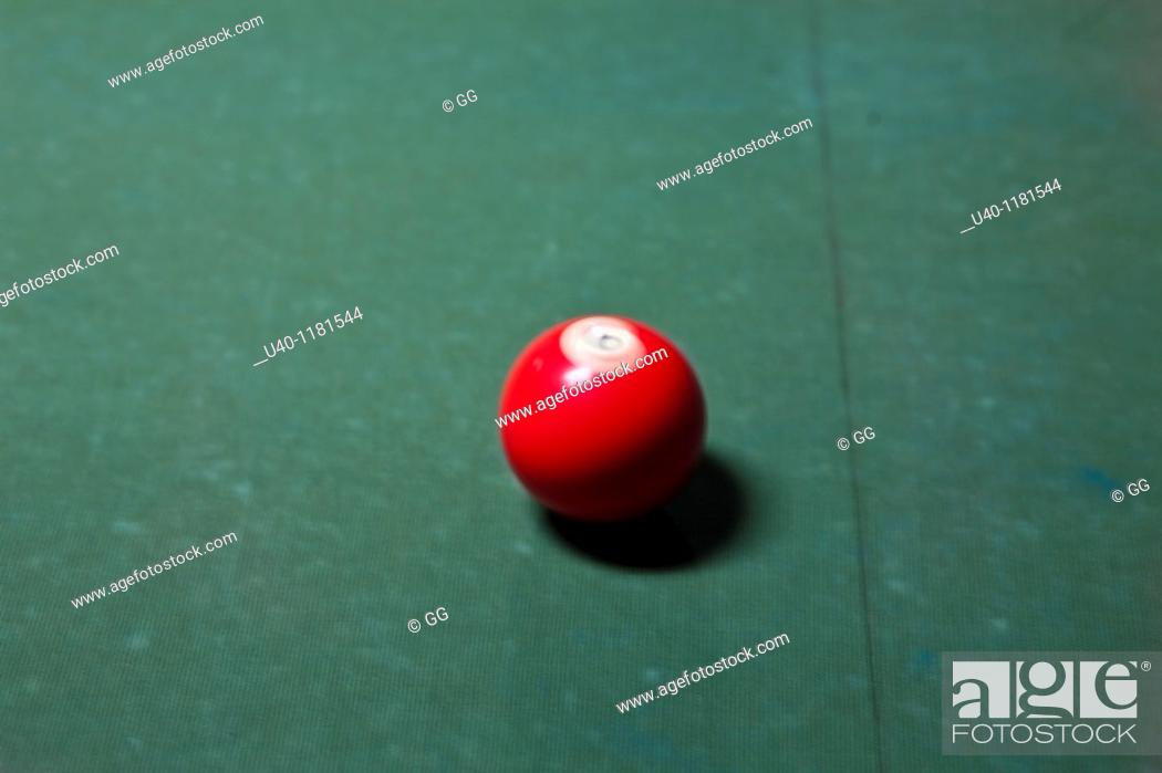 Stock Photo: Pool ball spinning on table.