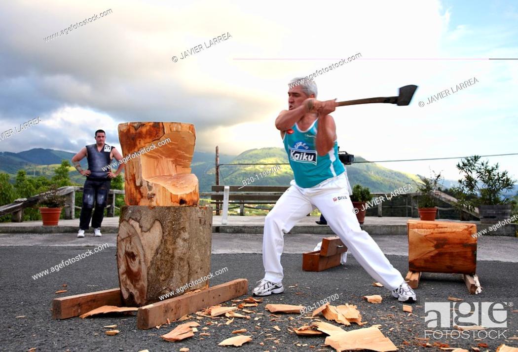 Stock Photo: Luis Txapartegi, Aizkolari (wood-chopping), Basque rural sport, Aduna, Gipuzkoa, Basque Country, Spain.