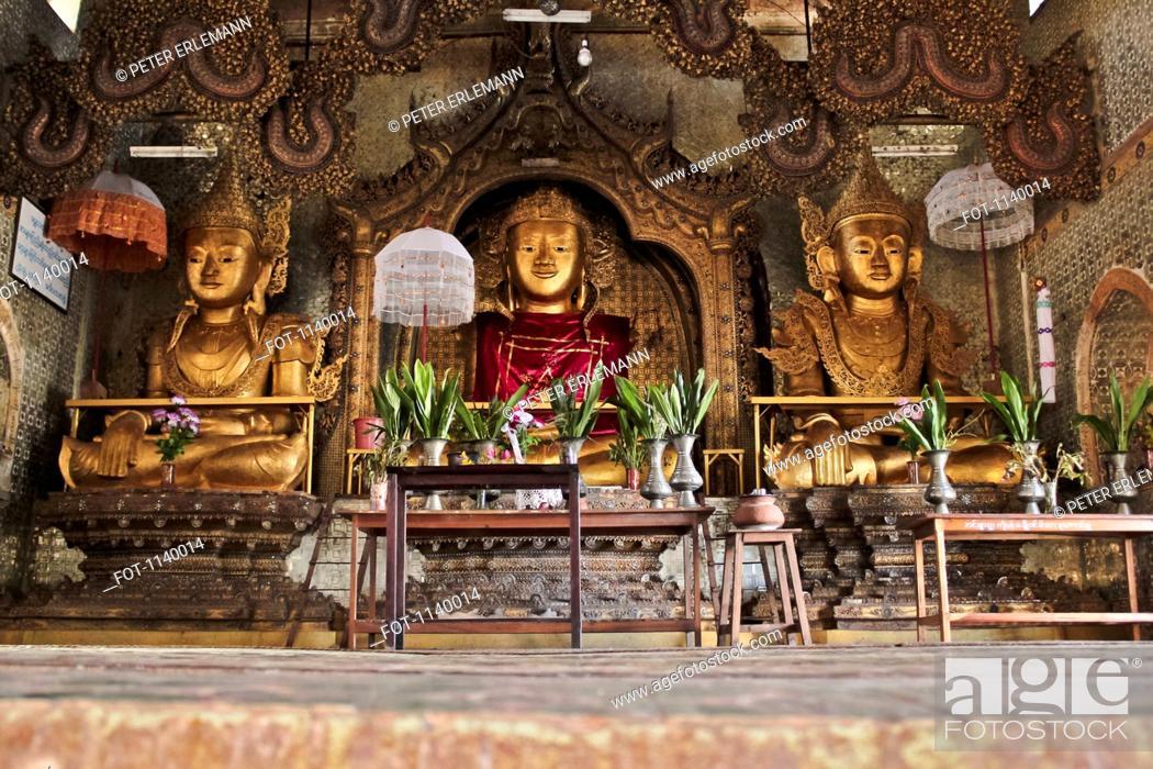 Stock Photo: A Buddhist shrine with three golden Buddhas, Inle Lake, Burma.
