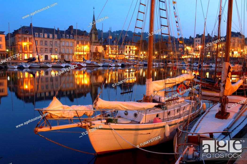 Stock Photo: Night harbour scene with yachts and restaurant lights. Honfleur, Normandy, France.