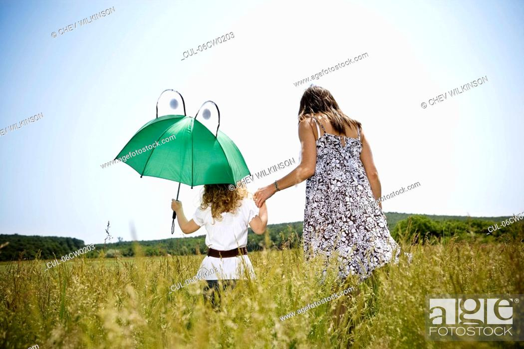 Stock Photo: Mother and daughter walking.