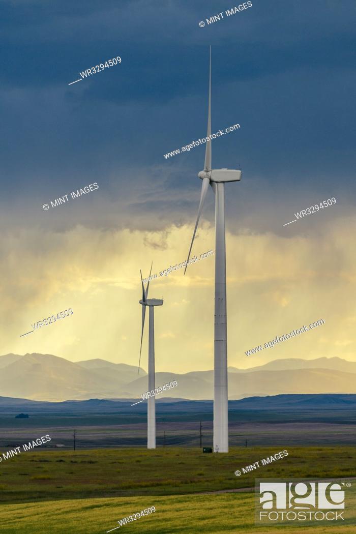 Stock Photo: Wind turbines at sunset.