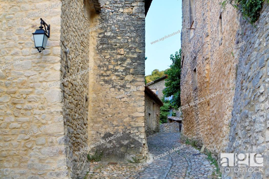 Stock Photo: Typical paved street in Roque-sur-Ceze, labelled The Most Beautiful Villages of France. Gard deparment, Languedoc-Roussillon region. France.