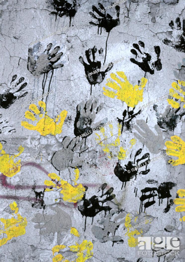 Stock Photo: Yellow, black, gray hand print on wall.