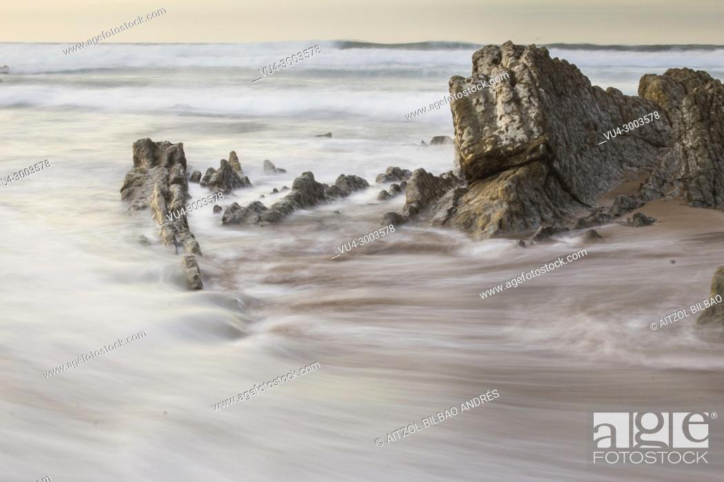 Stock Photo: Long exposure in Sopelana Beach, Basque country. When the tide is low the rocks appear, creating courious formations.