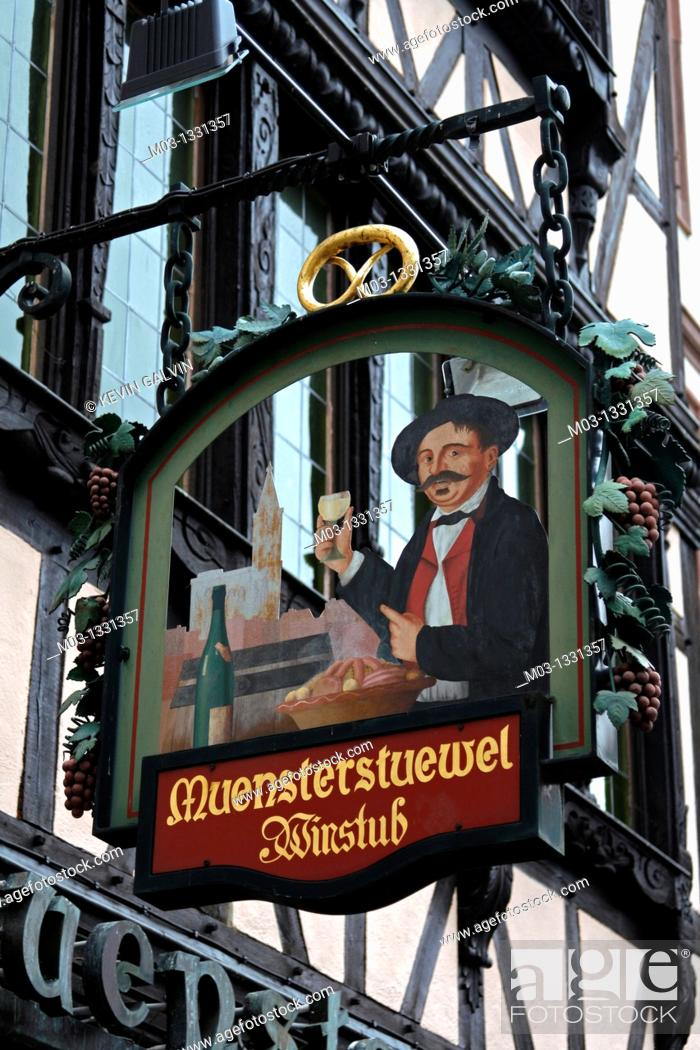 Stock Photo: France Alsace Strasbourg street scene signs restaurant cafe sign winestub.
