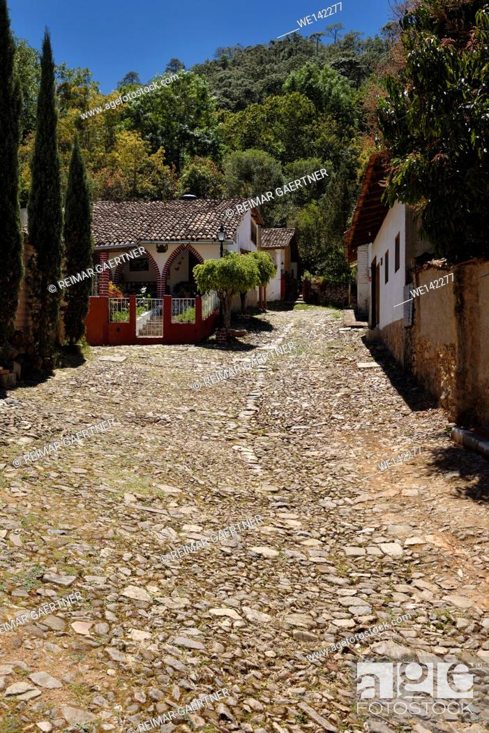 Stock Photo: Historic mining village San Sebastian del Oeste Mexico with stone hillside road.