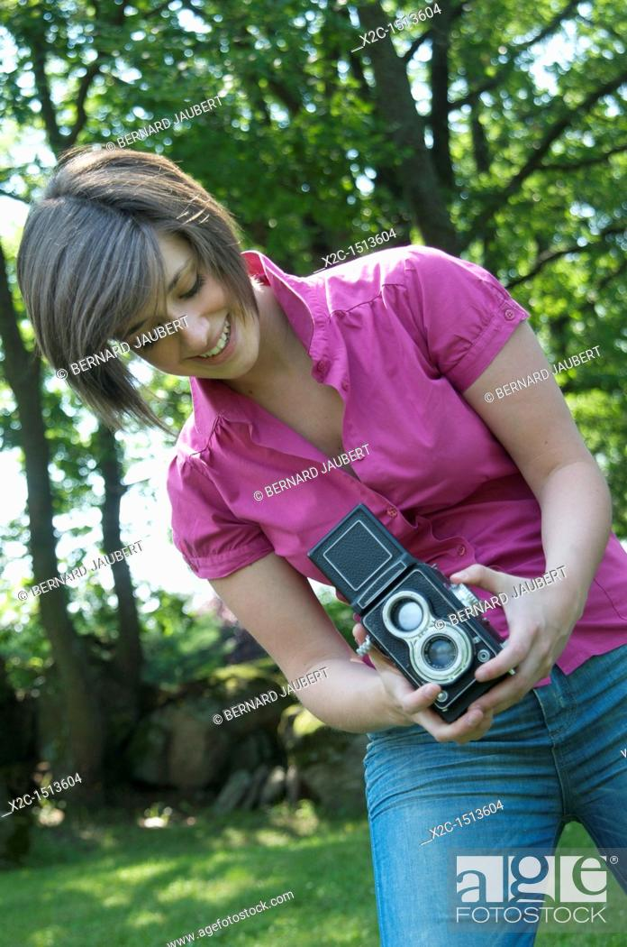 Stock Photo: Young woman photographing.