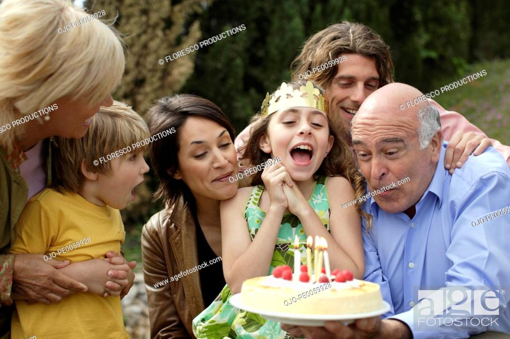 Stock Photo: Young girl celebrating birthday with family.