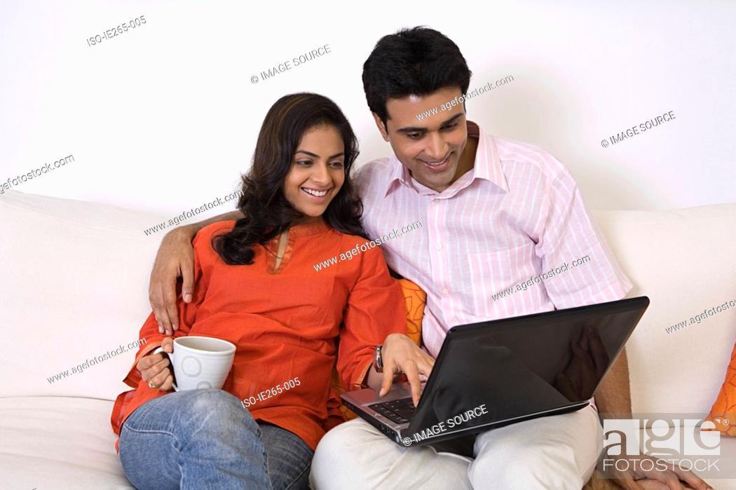 Stock Photo: A couple using a laptop.