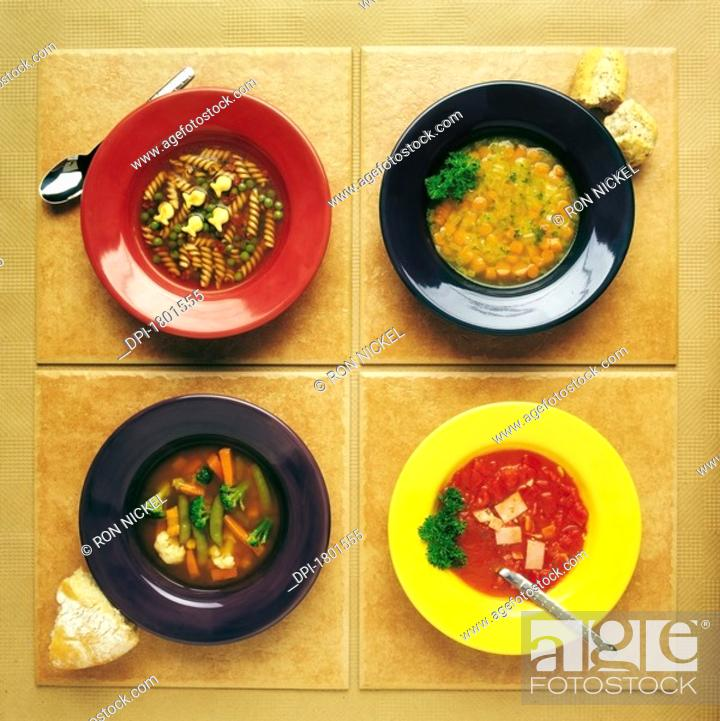 Stock Photo: Four dishes of different food.