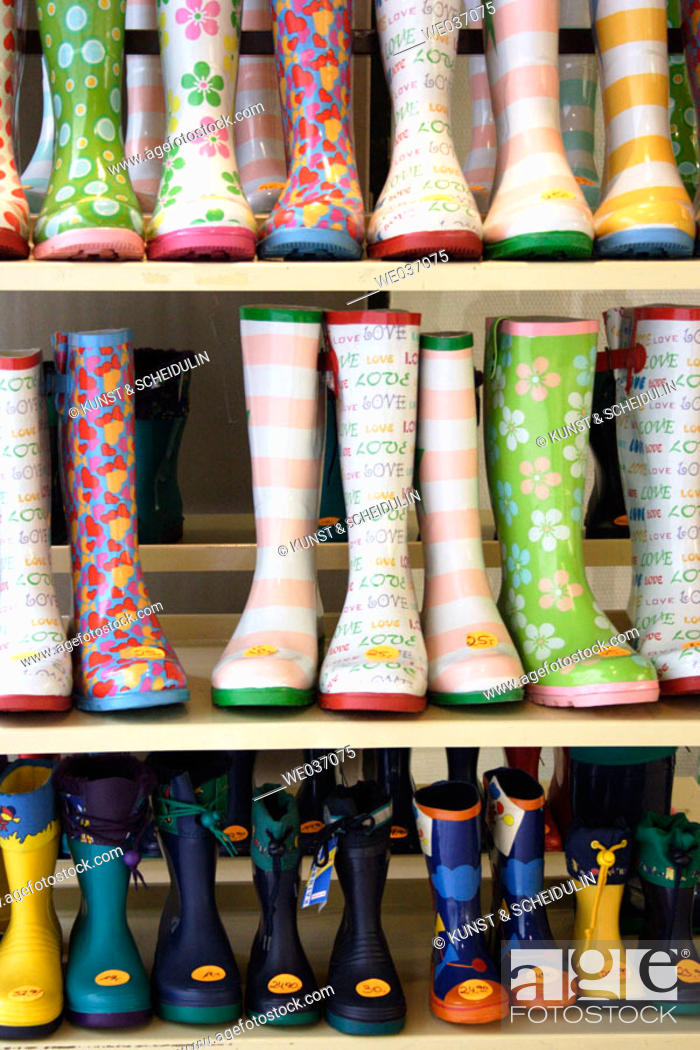 Stock Photo: Rubber boots on display before a shop.