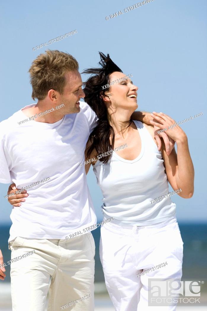 Stock Photo: couple walking on beach.
