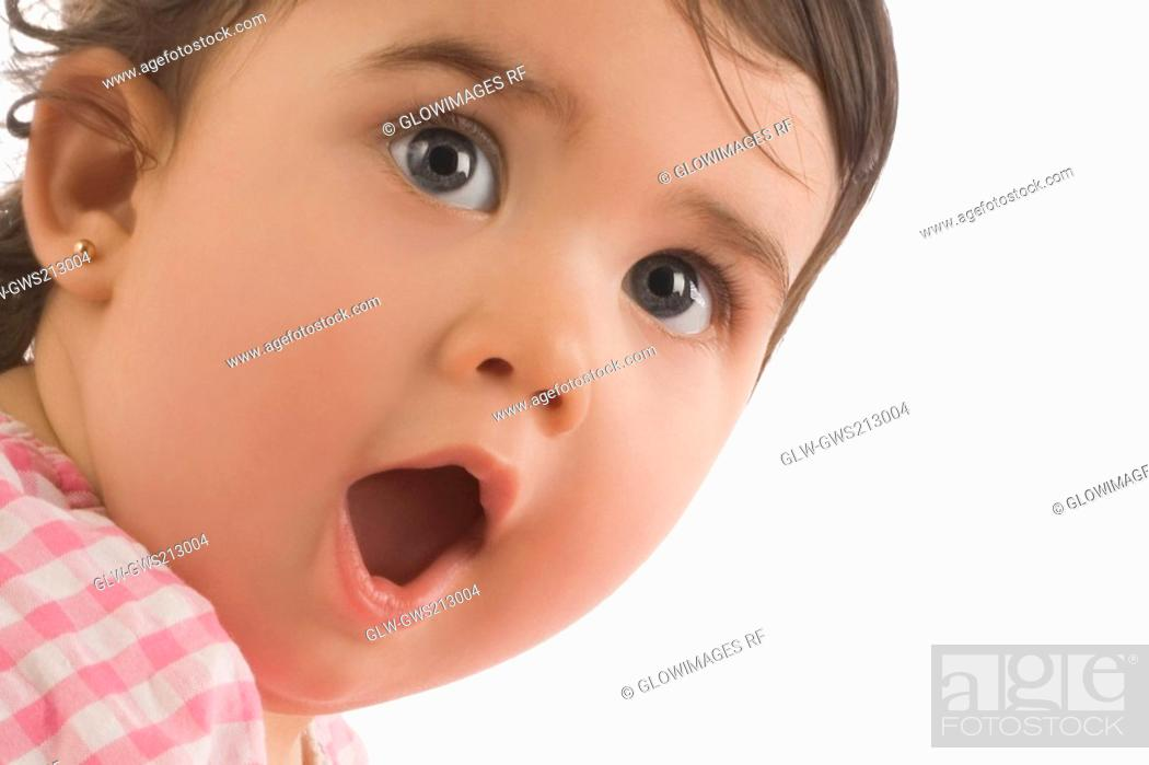 Stock Photo: Close-up of a girl with her mouth open.