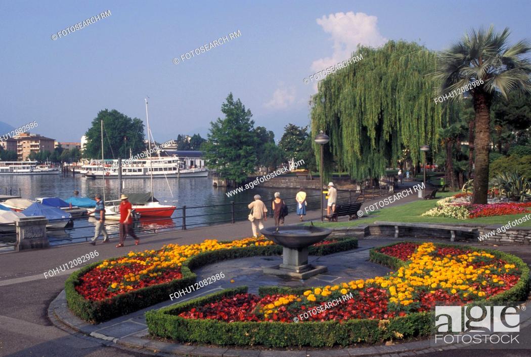 Stock Photo: Switzerland, Ticino, Locarno, Lakefront park along Lake Maggiore in the city of Locarno.