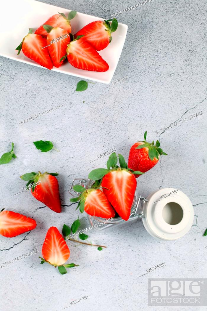 Stock Photo: Strawberries in white tray on stone background.