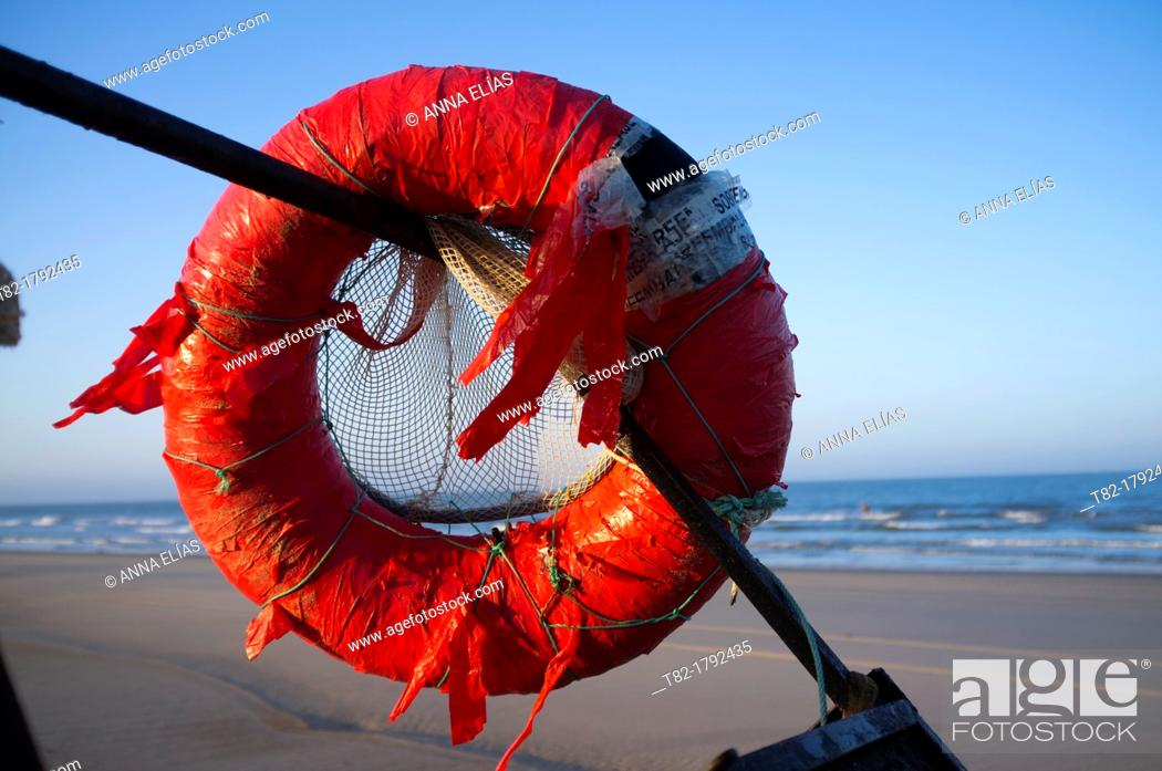 Stock Photo: Old red float fisherman on the beach at Doñana Natural park, Huelva, Andalusia, Spain, Europe.
