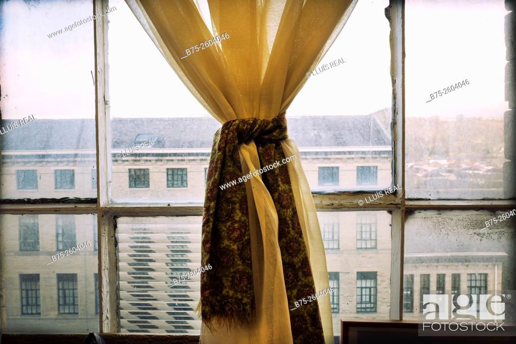 Stock Photo: Salts Mill building seen trough a window with a curtain. Saltaire Village, Shipley, Bradford, West Yorkshire, England, UK, Europe.