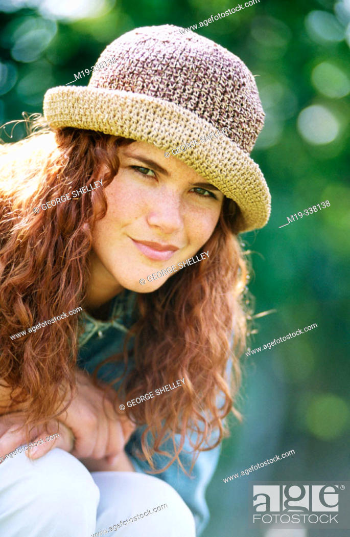Stock Photo: girl in a hat.