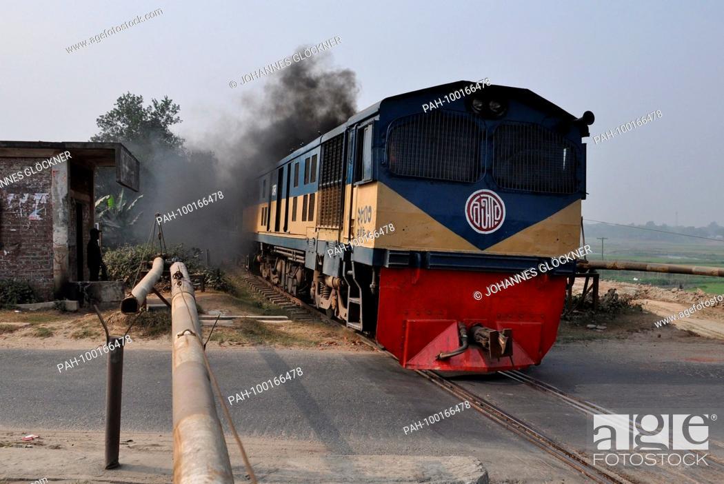 Stock Photo: Railroad crossing and train with diesel locomotive 2803 near Narsingdi on 09.01.2015 - Bangladesh. | usage worldwide. - Narsingdi/Dhaka/Bangladesh.