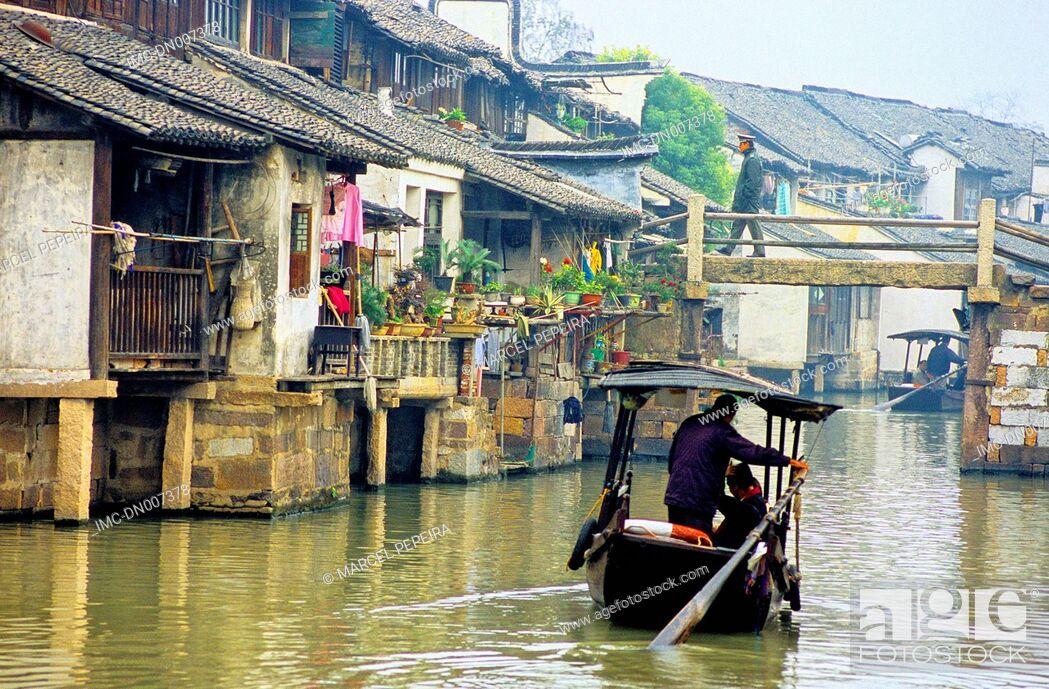 Stock Photo: China, Zhejiang, Wushen, boat on the canal.