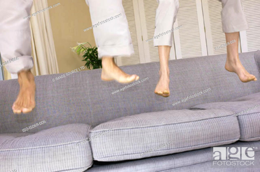 Stock Photo: Feet bouncing on sofa.