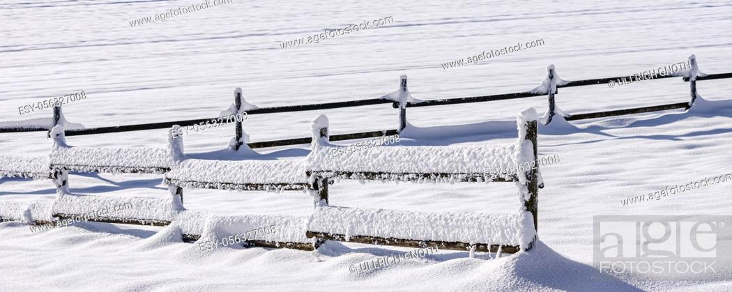 Stock Photo: Winter landscape of snow covered fields and wooden fence on the Swabian Alb near Lichtenstein, Baden-Württemberg, Germany.