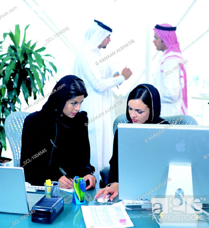 Stock Photo: Arab businesspeople in office environment.