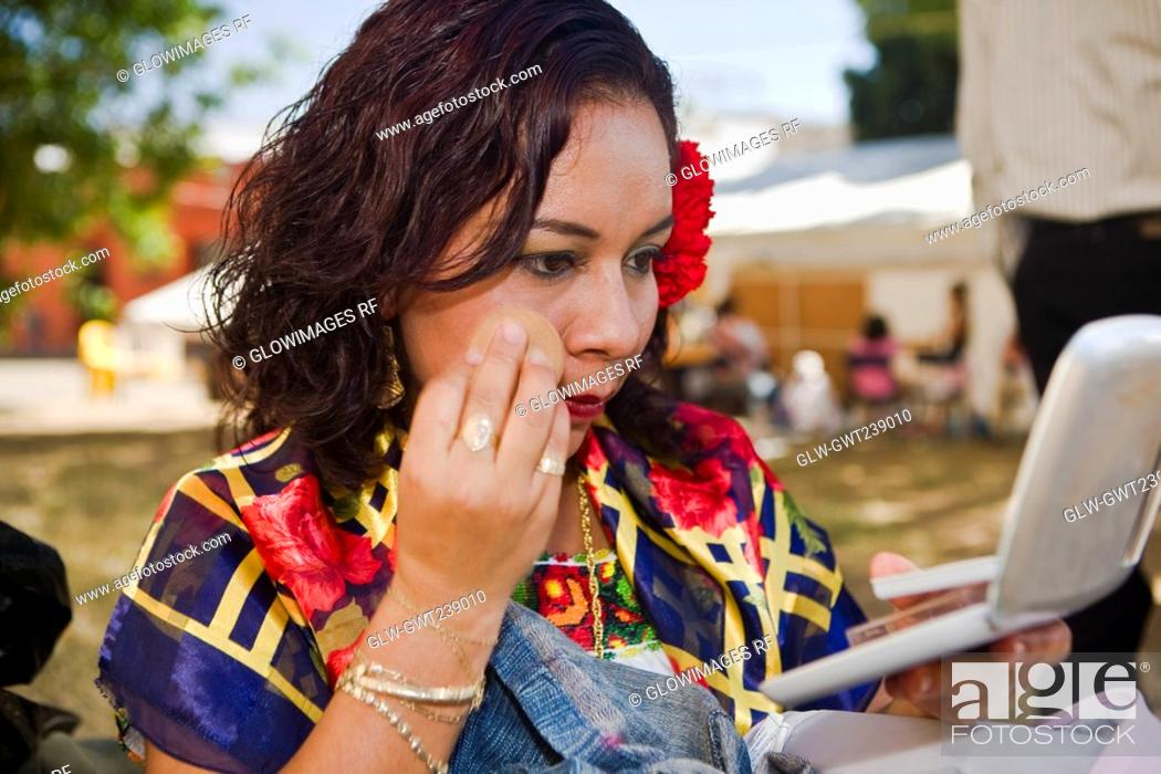 Stock Photo: Close-up of a female dancer applying face powder, Oaxaca, Oxaca State, Mexico.