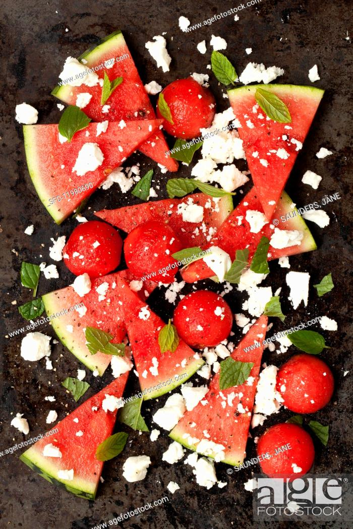 Photo de stock: Watermelon salad with feta cheese and fresh mint (seen from above).