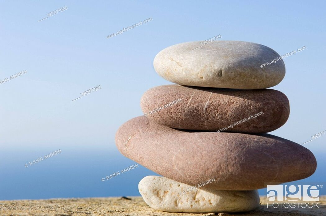 Stock Photo: Balancing rocks above the the sea.