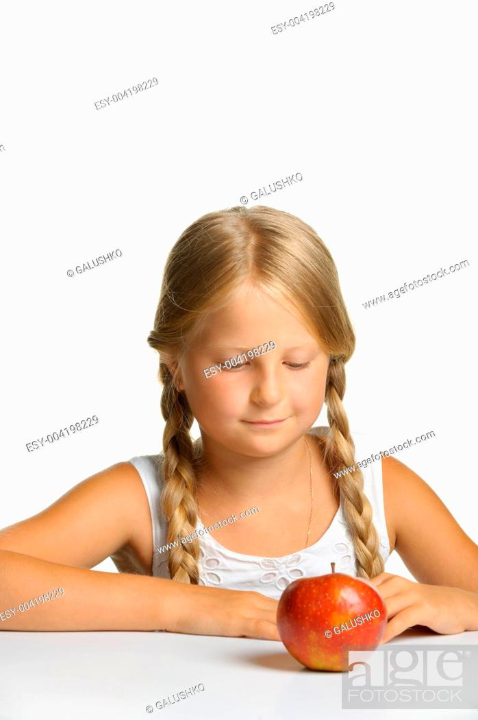 Stock Photo: The pretty girl wishes to eat an apple.
