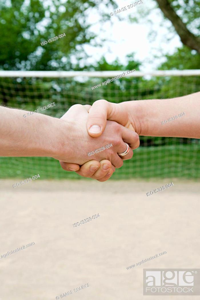 Stock Photo: Footballers shaking hands.