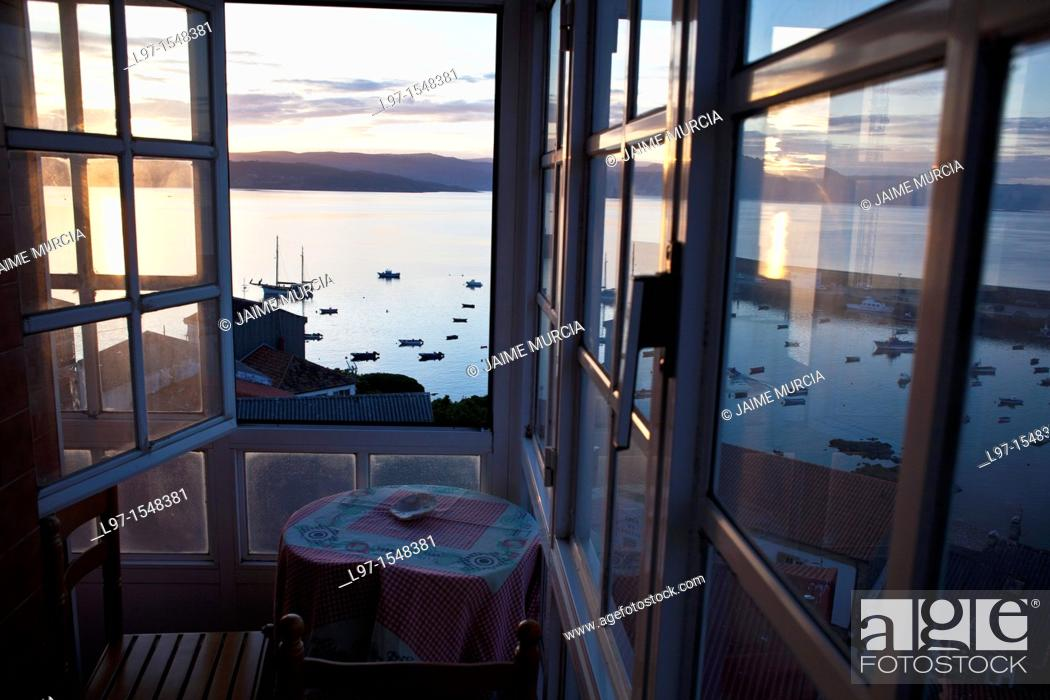 Stock Photo: Early morning view from hostel window over the harbor in the village of finisterre northern Spain.