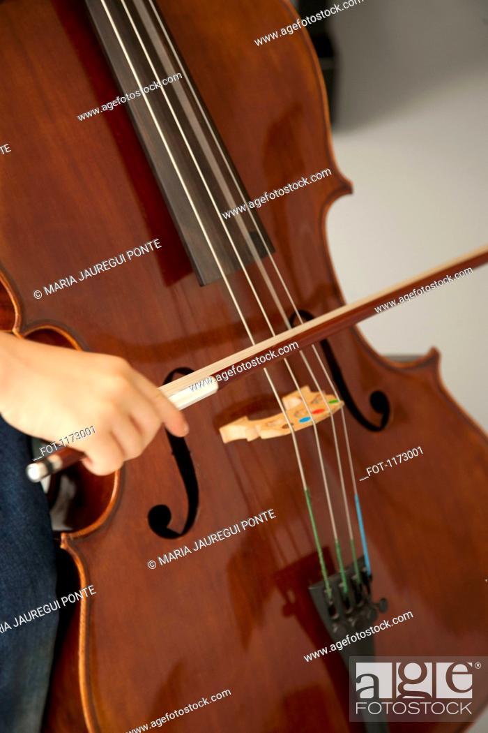 Stock Photo: Child playing cello.