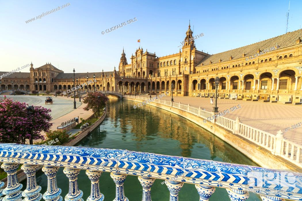 Stock Photo: Overview of canal and portico from a decorated glazed ceramic balustrade, Plaza de Espana, Seville, Andalusia, Spain.