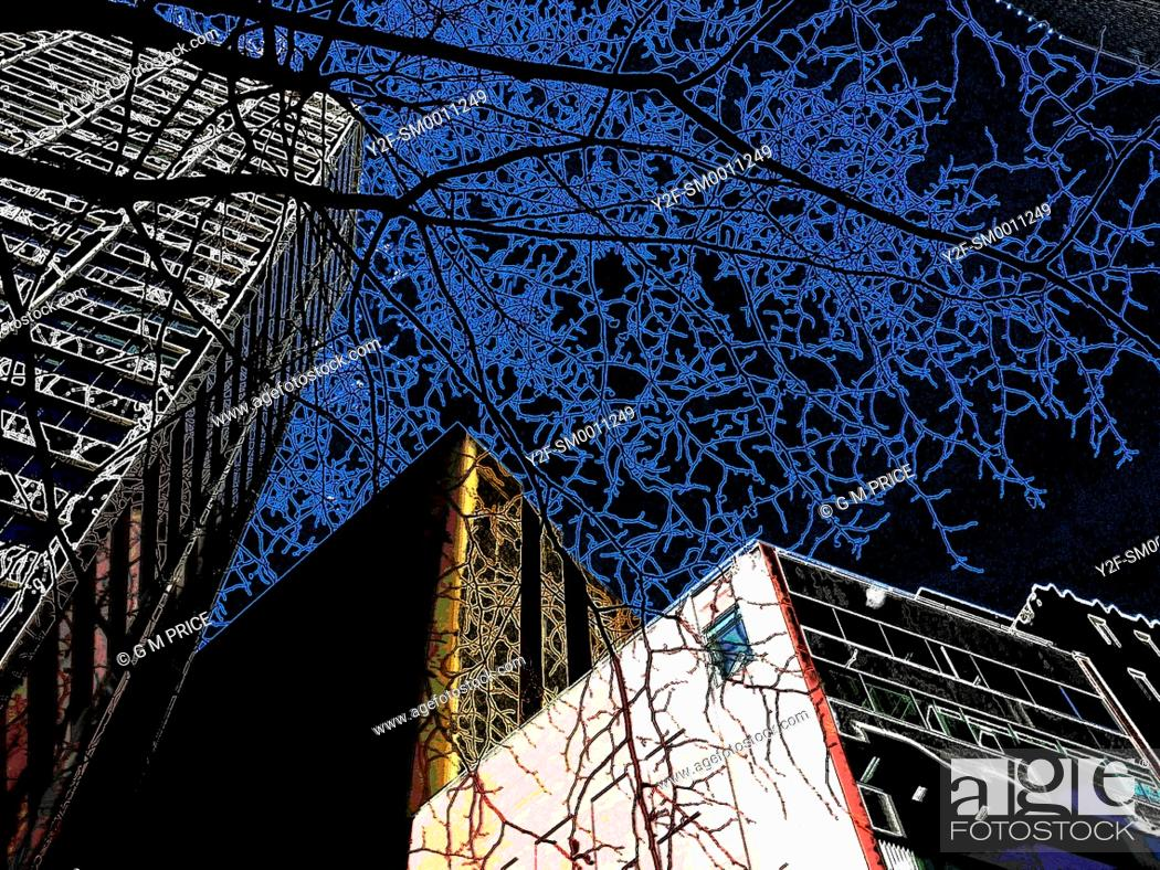 Stock Photo: strange, artificial colour image of building skyline and winter tree branches against a black sky.