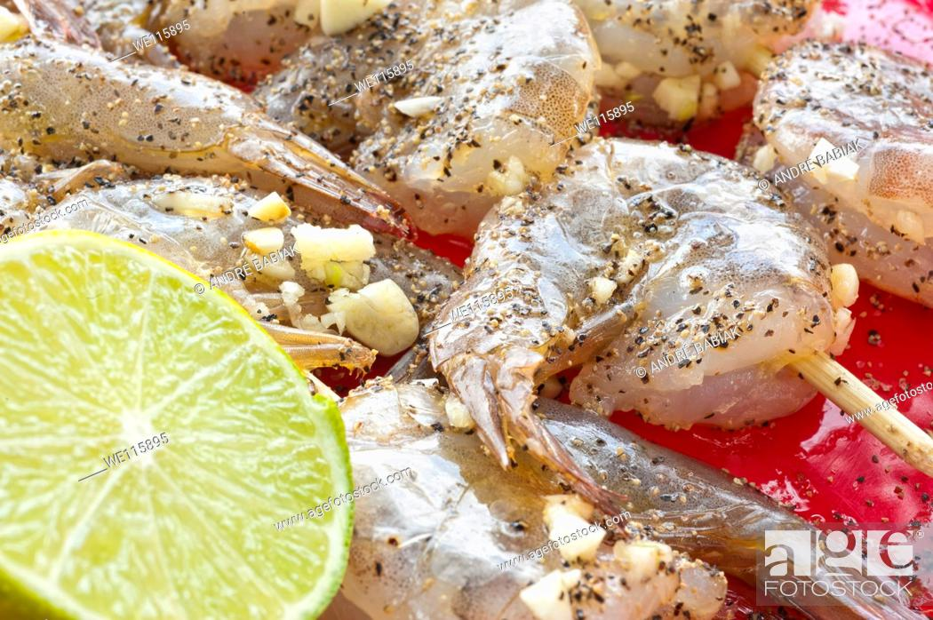 Stock Photo: Close up of shrimp skewers marinated with lime, garlic and black pepper.