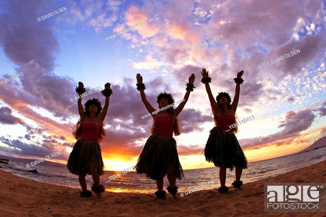 Stock Photo: Three hula dancers at sunset at Palauea Beach, Maui, Hawaii, USA.