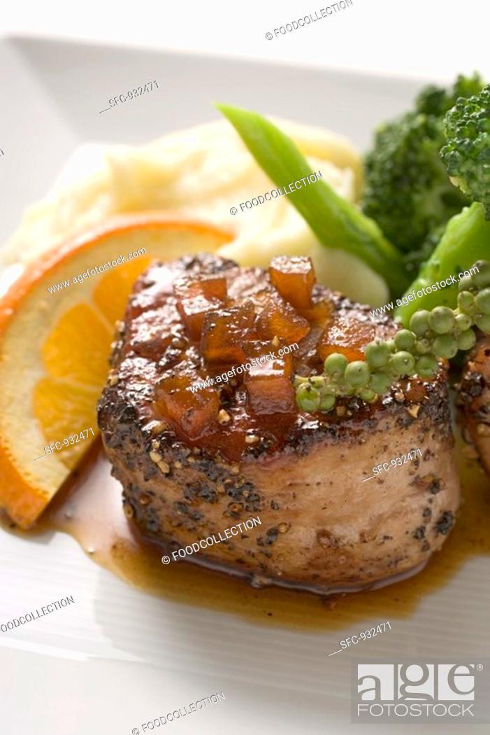 Stock Photo: Peppered pork tenderloin in orange sauce.