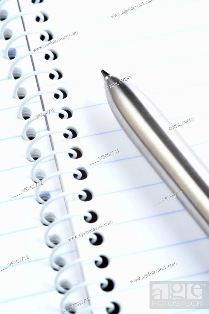 Stock Photo: Pen and spiral notepad.