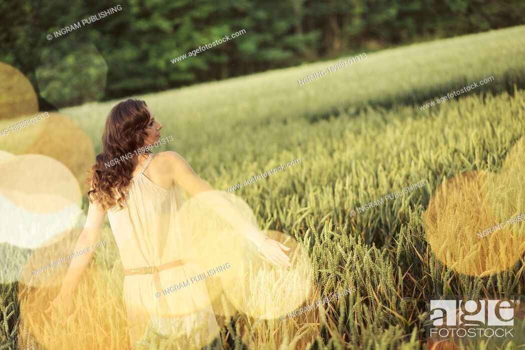Stock Photo: Vacation picture of the young woman among the corn crop.