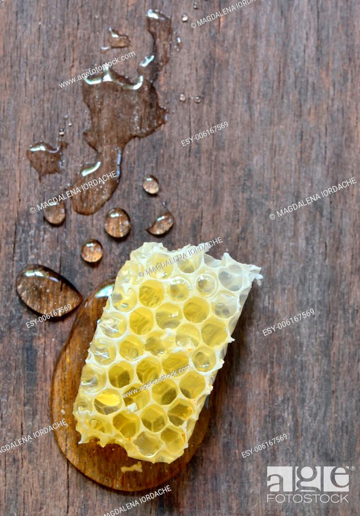 Stock Photo: sweet honeycombs with honey isolated on old wooden background.