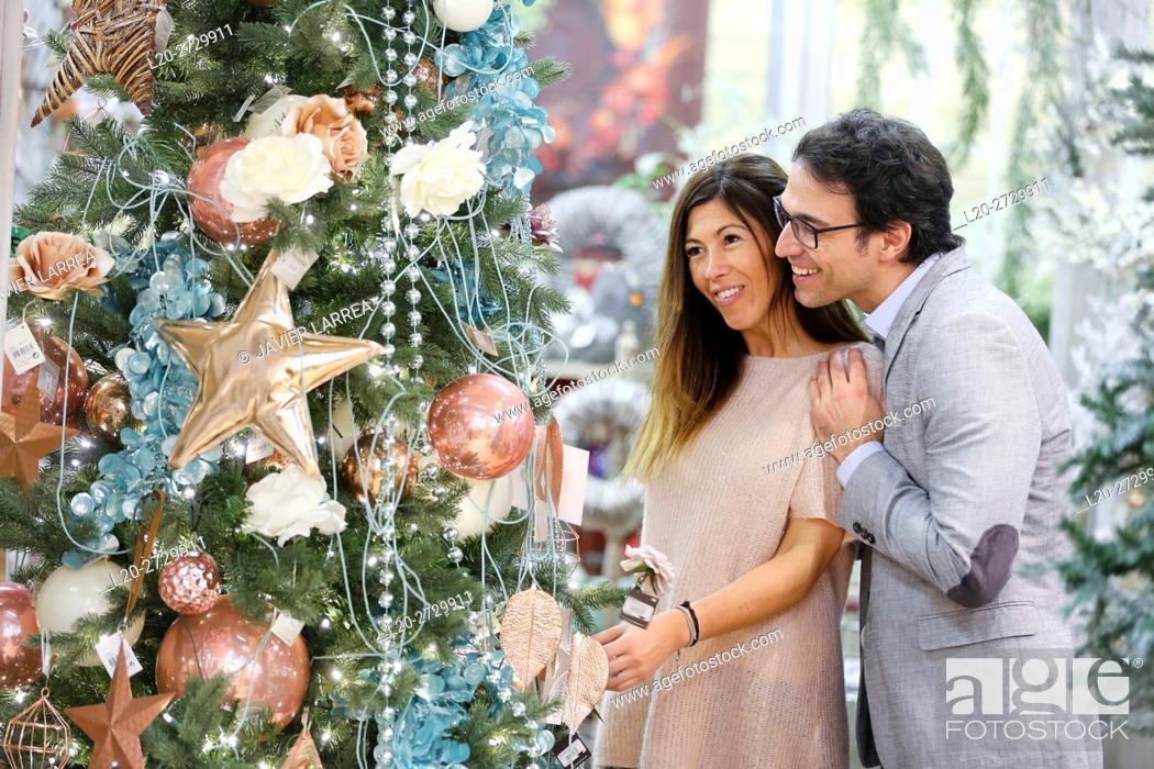 Stock Photo: Couple buying Christmas ornaments in garden center.