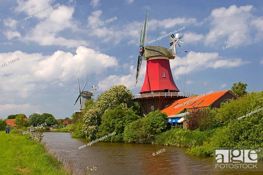 Stock Photo: Windmills twin mills Greetsiel Lower Saxony Germany.